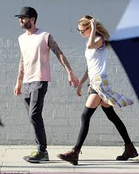 Adam levine and his wife, behati prinsloo, just announced that they're expecting their first child! Behati Prinsloo Shares A Tender Kiss With Adam Levine On Set Of Animal Daily Mail Online