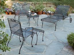 black wrought iron outdoor furniture. Gorgeous Patio Design Using Black Wrought Iron Chair And Round Table By Woodard Furniture Plus Stone Floor Outdoor I
