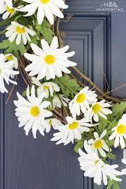 daisy flower wreath on blue door close up