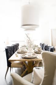 eclectic dining room design with rustic wood dining table black leather tufted wingback dining chairs