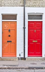 Red And Orange Front Doors On Adjoining Terraced Homes In The ...