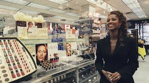iman in front of a cosmetics counter selling her range of make up photo simonpietri sygma via getty images
