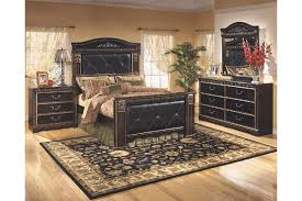 silverglade mansion bedroom set by signature design. brown queen mansion bedroom set adorned with ornate appliques and antique gold brushing silverglade by signature design t