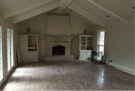 after below by removing the awkward cabinets and removing the old mantle the room became an blank canvas to add interest an asymmetric design was