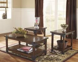 wood coffee table set. Ashley Furniture Coffee And End Tables Murphy Three Piece Hardwood Varnished Simple Inexpensive Soft Floral Pattern Wood Table Set