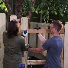 after installing the fence gate attach the pickets using a guide string