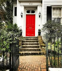 lover of light 78 on insram the clic red door on a white house with black shutters