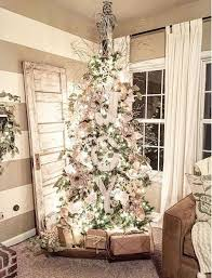Cozy rustic outdoor christmas decoration ideas Patio Rustic Christmas Tree Decorating With Burlap Wooden Joy Letters Craft Bouse World 35 Rustic Farmhouse Christmas Decoration Ideas Craft Bouse World