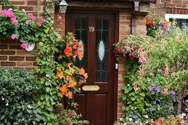 front door red brick entrance garden flowers