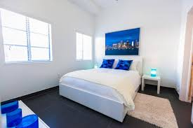 White Bedroom Furniture Sets With White Blue Wall Window And Black Ceramic  With White Blue Bde Pillow Blanket And Brown Carpet Nightstand Table