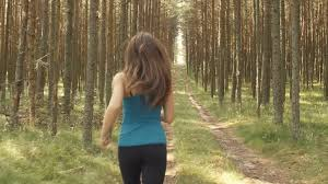 Girl running through woods