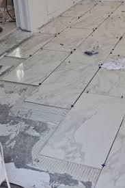 laying tile in bathroom. beginner\u0027s guide to laying tile (a beautiful mess) in bathroom