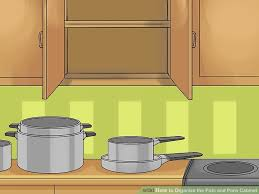 how do i organize my kitchen cabinets awesome how to organize the pots and pans cabinet