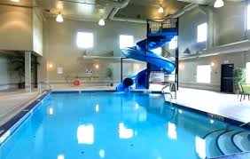 Indoor pool with slide Mini View Inthemoodforco Home Listed For Sale On Rocky Beach Road Bedrooms Indoor Pool