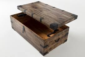 That balance of the two different materials is what gives off the industrial feel. Wally Lift Top Trunk Coffee Table Living Spaces