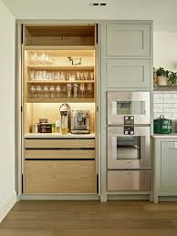On the other side, the vertical coffee decal is perfectly placed over the cabinet to beautify the coffee bar. 20 Refreshing Coffee Bar Ideas For Your Home