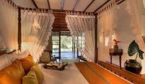 Orange And Brown Bedroom Lily Pool Villa Coorg