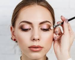 make up artist applying eyeshadow