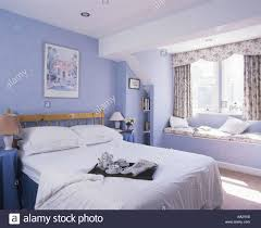 Modern Blue Bedroom Bed With Breakfast Tray On White Quilt In Modern Pastel Blue