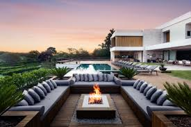 square fire pit in a contemporary outdoor lounge