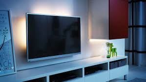 tv with led light strips behind