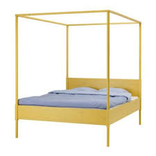 But in the new IKEA Catalog 2008, we couldn't help stopping at the Hemnes  four-poster bed frame.