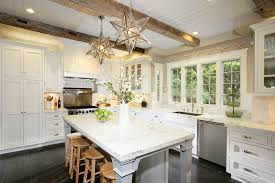 dazzling moravian star pendant light fixture on the top of kitchen island together with wooden white