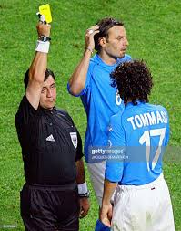 Referee Byron Moreno hands out a yellow card to Italian midfielder... News  Photo - Getty Images