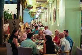 Customers enjoy the outdoor seating at avocado grill west palm beach richard graulich