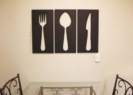 large wall art of fork spoon and knife wood cutouts image