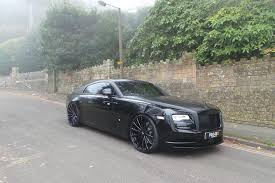 rolls royce wraith white with black rims. rolls royce wraith tuning forgiato wheels 7 round in black on white with rims