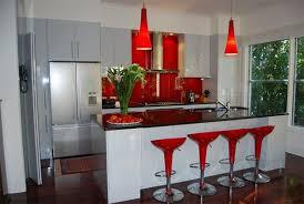 red chairs backsplash. Beautiful contemporary kitchen!