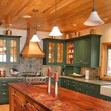 rustic painted cabinets. These Greenpainted Cabinets Contrast Beautifully With The Woodpaneled Ceiling And Butcherblocktopped Center Island Of This Rustic Kitchen Painted
