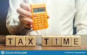 Time And Pay Calculator Wooden Blocks With The Word Tax Time And Taxpayer With A