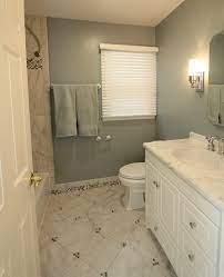 Bathroom Renovation Cool Tones With Mosiac Tile Baseboards