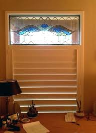 austin window stained glass art fit perfectly inside the custom shutter frame louvers open window fashions
