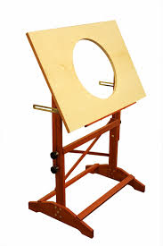 you can also purchase a wooden drafting table with the hole pre cut from cartoon colour co