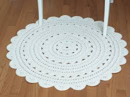 image of white round rugs for nursery