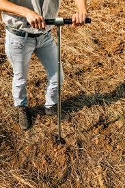 Soil Sampling Agronomist Taking Sample With Soil Probe Sampler