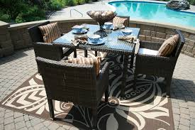 the via collection 4 person all weather wicker patio furniture dining set
