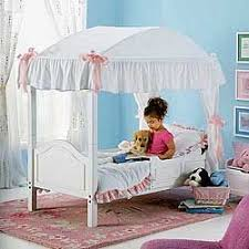 this is kindof the idea I have to convert Laurens crib into a canopy ...
