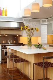 View in gallery Beautiful yellow kitchen island flowers