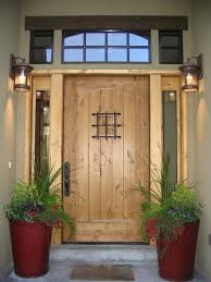 outdoor living modern front door decor with brown rustic wooden door and modern glass front door lantern in classic style plus red tall ceramic potted