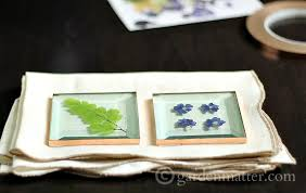 pressed flower glass coasters using square glass and copper tape flowers from you own backyard in