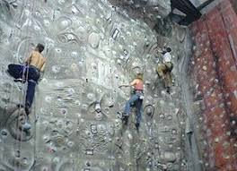 an indoor rock climbing wall in the uk showing moulded features and coloured route markers  on artificial rock climbing wall cost with climbing wall wikipedia