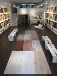 >tiling ideas for showroom floors google search showroom  lv wood floors showroom in nyc espresso bar at rear is freestanding white six inch thick concrete with six inch thick polished concrete legs