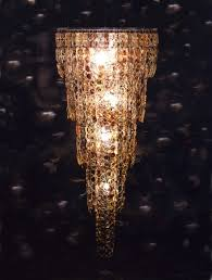 chandeliers have always been elegant light sources adorning grand dining rooms ballrooms and even the castles of yesteryear repurposing therefore might