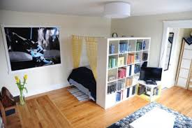 something similar in one of our friends apartments but this clever guy puts the very ordinary book shelf in a whole new light for me cosy and clever