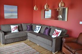 Red Wall Living Room Decorating Modern Living Room Designs With Red Wall Color And Corner Sofa