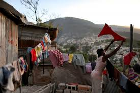 photo essay s earthquake victims wonder where the a w hangs her laundry to dry in front of her home made out of tin